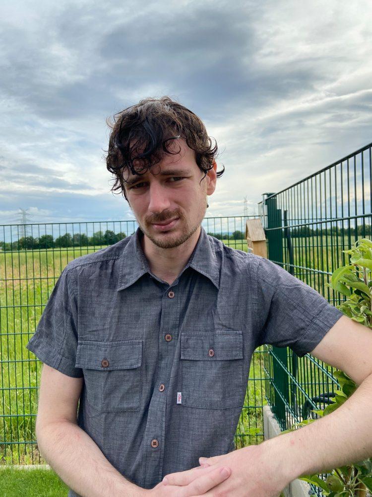 Porträtfoto: Johannes Senk mit nassen Haaren
